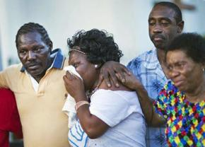 Parishioners at the Emanuel AME church mourn the victims of the massacre