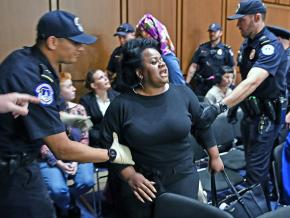 Protesters stand up to Brett Kavanaugh during his Senate confirmation hearing