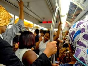 Commuters ride the New York City subway