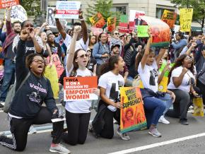 Protesters take a knee during the March for Racial Justice in Washington, D.C.
